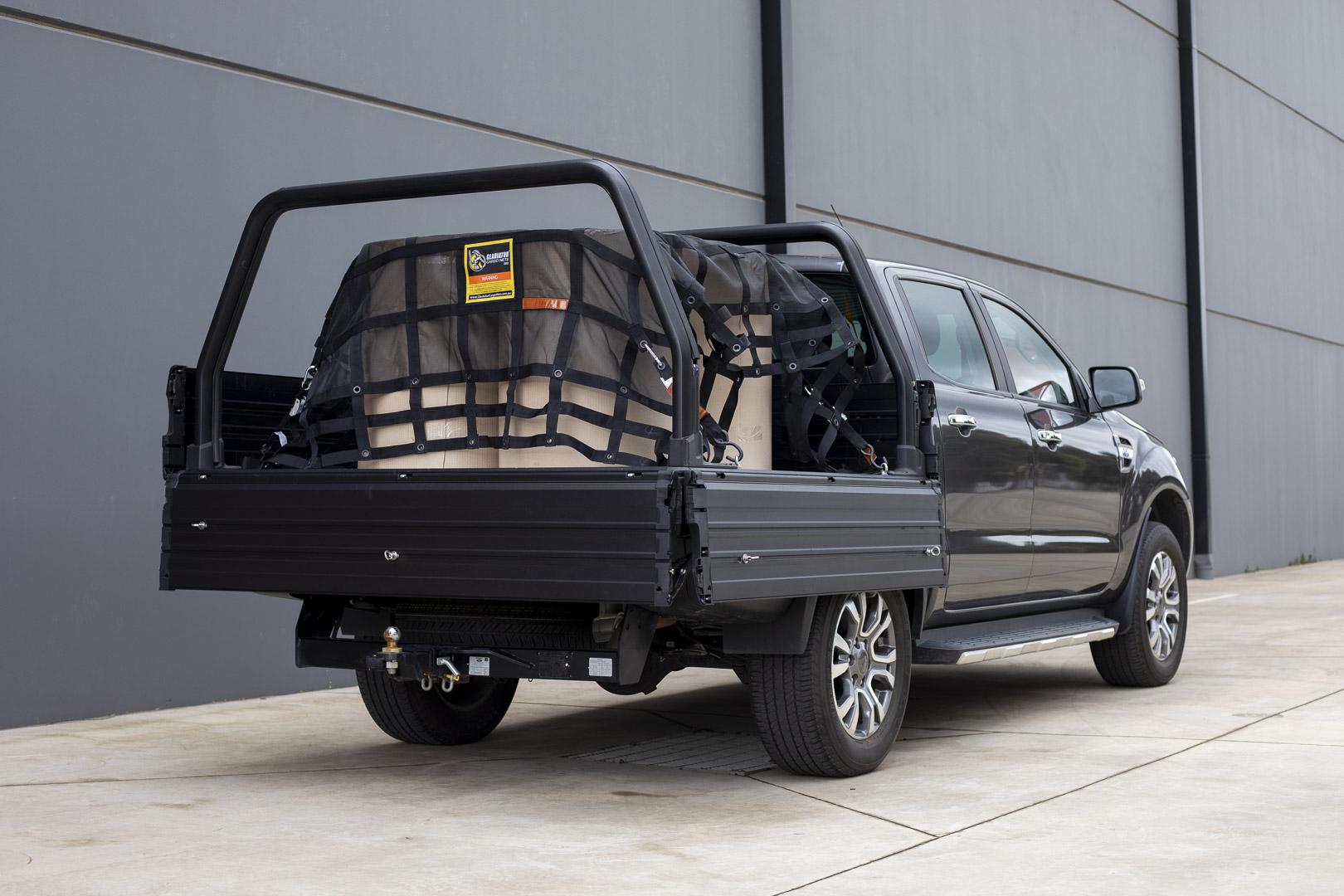 Comtruk ute tray with XT150 rack bars and Gladiator Cargo Net